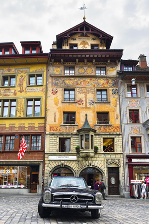 LUCERNE, SWITZERLAND - JUNE 14, 2017: Vintage oldtimer Mercedes Benz 250 SL Convertible car parked on the picturesque Weinmarkt square in Luzerne