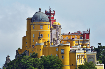 View of Pena National Palace in Sintra in a beautiful summer mist sunrise, Portugal