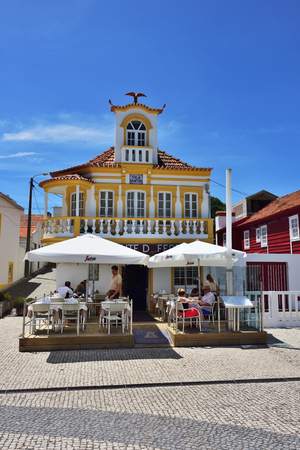 Costa Nova, Portugal - June 9, 2017: Street cafe in the famous resort on the Atlantic coast in Beira Litoral. Popular tourist destination to spend vacation time