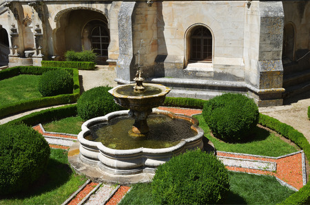 Luso, Portugal - June 10, 2017:  Ancient fountain in garden of the medieval Bussaco Palace near Luso in Portugal. Palace built in 1628 as a convent