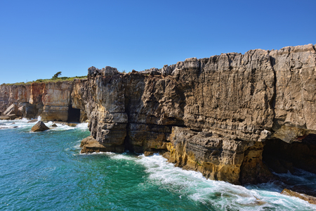 Boca do inferno - stone arches and grotto, the natural wonder on the Atlantic ocean coast nearby Cascais, Lisbon, Portugal