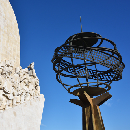 LISBON, PORTUGAL - JUNE 11, 2017: Armillary sphere and monument to the Discoveries (Padrao dos Descobrimentos) at the Tagus river. Armillary sphere is simbol of Portugal Editorial
