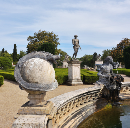 Queluz, Portugal - June 3, 2017: Neptune gardens, fountain baroque in the Queluz Royal Palace. Summer residence by the Portuguese royal family. Focus on the foreground Editorial
