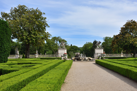 Queluz, Portugal - June 3, 2017: View on the entrance in Neptune garden, baroque fountain and sculptures by sculptor John Cheere in the Queluz Royal Palace