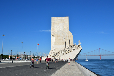 Lisbon, Portugal - June 11, 2017: Monument to the Discoveries (Padrao dos Descobrimentos) at the Tagus river with view on 25th of April Bridge