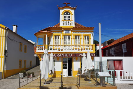 Costa Nova, Portugal - June 10, 2017: Restaurant in the famous resort on the Atlantic coast in Beira Litoral, Portugal. Popular tourist destination to spend vacation time Imagens - 87196391