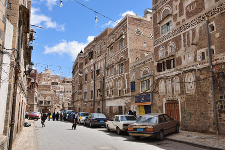 Sanaa, Yemen - March 6, 2010: Typical street in the old city of Sanaa. Inhabited for more than 2.500 years at an altitude of 2.200 m, the Old City of Sanaa.