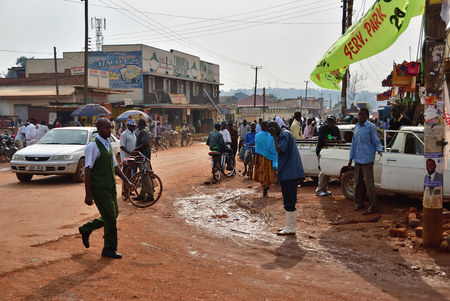 Kampala, Uganda - AUG 26 2010: Native people in slum of Kampala. Nearly 40% of slum dwellers have a monthly income of just 2500 shillings less than a dollar Editorial