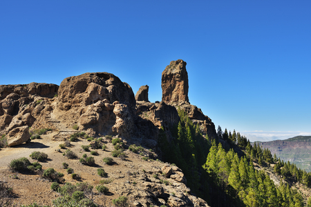 Symbol of the island Gran Canaria Roque Nublo (rock in clouds) is an ancient and sacred place of worship and main tourist attraction Stock Photo