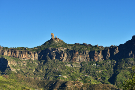 Landscape with the symbol of the island Gran Canaria Roque Nublo (rock in clouds) is an ancient and sacred place of worship and main tourist attraction Stock Photo