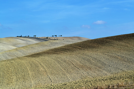 Idyllic Tuscan landscape near Pienza, Italy. Hills with plowed fields at autumn time Stock Photo