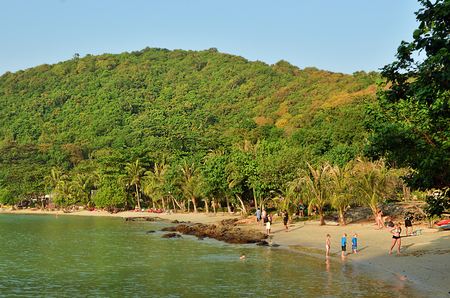 Koh Samet,Thailand - Dec 26, 2011: Tropical sandy beach of Samet island with a lot of tourists relaxing and sunbathing
