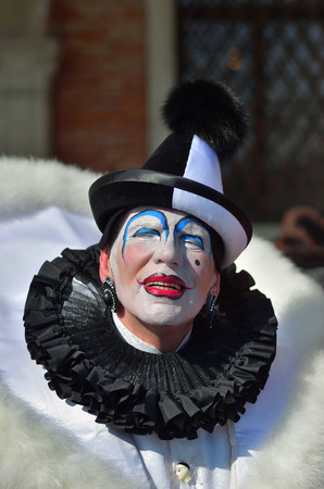 Venice, Italy - March 6, 2011: An unidentified masked person in costume Pierrot in St. Mark's Square during the Carnival of Venice. The 2011 carnival was held from February 26th to March 8th