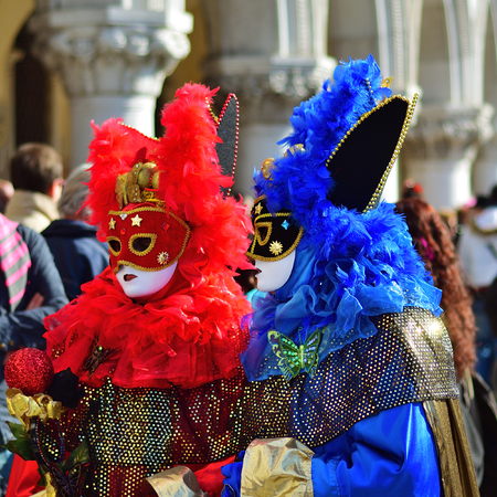 Venice, Italy - March 6, 2011: Two unidentified masked persons in costumes in St. Marks Square during the Carnival of Venice. The 2011 carnival was held from February 26th to March 8th