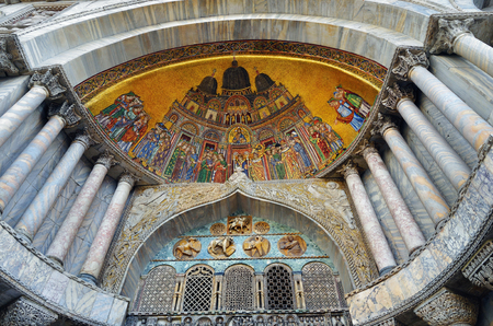 The byzantine mosaic on the artistic facadeof the famous Basilica di San Marco (St. Marks Cathedral) at Piazza San Marco (St. Marks Square) in Venice, Italy