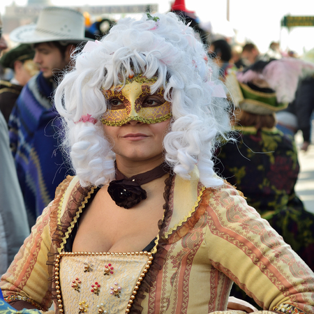 Venice, Italy - March 6, 2011: An unidentified participant in mask on St. Marks Square during the Carnival of Venice. The 2011 carnival was held from February 26th to March 8th