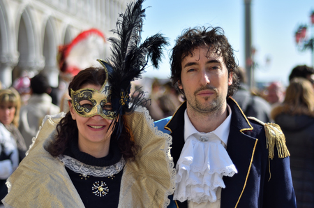 Venice, Italy - March 6, 2011: Unidentified  participants in costumes on St. Marks Square during the Carnival of Venice. The 2011 carnival was held from February 26th to March 8th