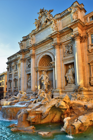 The Fontana di Trevi (Trevi Fountain) shown at sunset light, Rome, Italy. The Trevi Fountain was finished in 1762 by Giuseppe Pannini