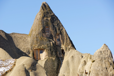 View of Cappadocia. Turkey. Ancient cave monastery among unusual mountain landscape Stock Photo