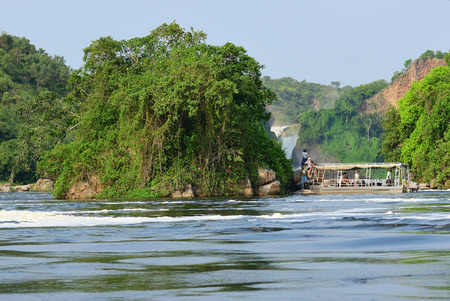 Uganda - Aug 27, 2010: Tourists visit the Murchison Falls, also known as Kabarega Falls, is a waterfall between Lake Kyoga and Lake Albert on the White Nile River in Uganda.