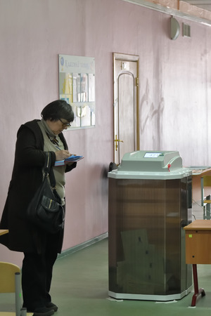 Moscow, Russia - March 18, 2018: The election in Russia.An election observer at a polling station and a sealed ballot box