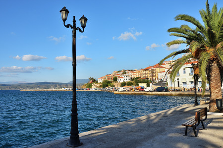 Pylos, Greece - Oct 8, 2013: Promenade of Pylos shown at sunset. One from most popular tourist destination in Messinia, located in Navarino bay, Greece
