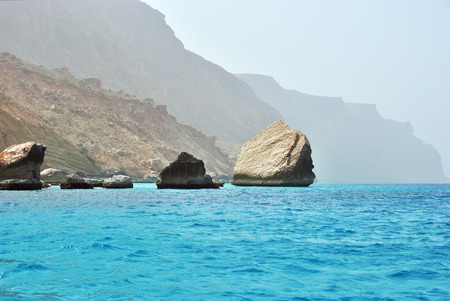 Cliffs above azure water of the Arabian Sea nearby Ras Shuab, Shuab Bay beach, one of the most famous beaches of the island of Socotra