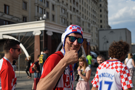 Moscow, Russia - June 23, 2018. World Cup 2018, Croatian football fans walking down on the streets in Moscow. FIFA world cup, Mundial 2018 Редакционное