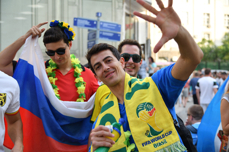 Moscow, Russia - June 23, 2018: Brazilian football fan on the streets of Moscow. Soccer fans from abroad walking down the Nikolskaya streets in Moscow, FIFA world cup, Mundial 2018 Редакционное