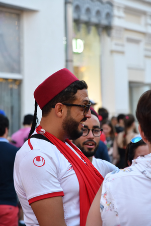 Moscow, Russia - June 23, 2018: Tunisian fans on Nikolskaya street in Moscow. Soccer fans from abroad walking down the Nikolskaya streets in Moscow, FIFA world cup, Mundial 2018 Редакционное