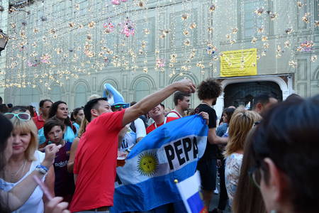 Moscow, Russia - June 23, 2018: Japan football fans take a selfie with argentina fans on the Nikolskaya street in Moscow. FIFA world cup, Mundial 2018 Редакционное