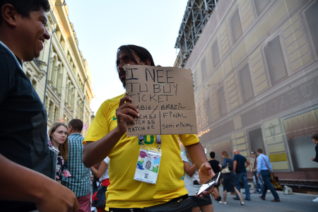 Moscow, Russia - June 26, 2018: Brazilian football fan on the streets of Moscow. Soccer fans from abroad walking down the Nikolskaya streets in Moscow, FIFA world cup, Mundial 2018 Редакционное