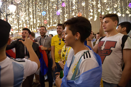 Moscow, Russia - June 26, 2018: Argentinian football fan girl on the night streets of Moscow. Soccer fans from abroad walking down the Nikolskaya streets in Moscow, FIFA world cup, Mundial 2018 Редакционное
