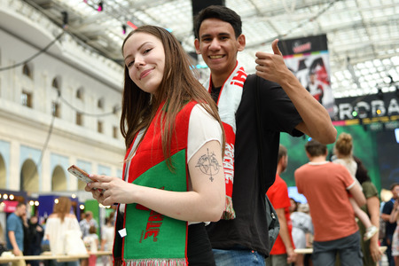 Moscow, Russia - June 23, 2018: Soccer fans from Mexica on the Ilyinka street in Moscow, FIFA world cup, Mundial 2018 Редакционное
