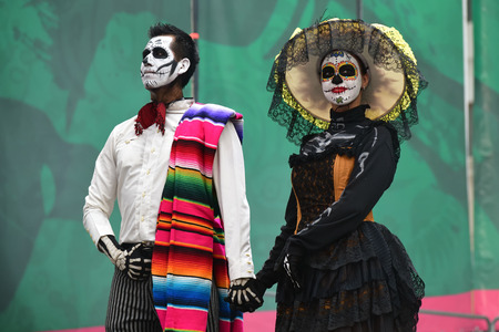 Moscow, Russia - June 29, 2018: Participants in traditional clothing during Dia de los Muertos Mexican carnival. Sugar skull makeup. Day of The Dead Editorial