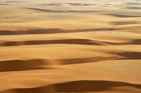Aerial view on the beautiful landscape of the Namib Desert at sunset. Flying on a small plane over the desert is one of the most popular tourist attractions in Namibia. Africa 免版税图像