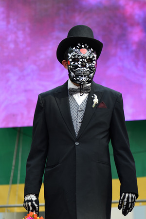 Moscow, Russia - June 29, 2018: Man in sugar skull mask during Dia de los Muertos Mexican carnival. Day of The Dead