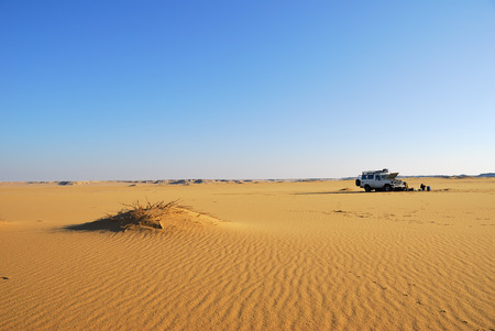 Sahara Desert safari off-road vehicle parking for camp into the sand desert nearby Dakhla oasis in Egypt, Africa