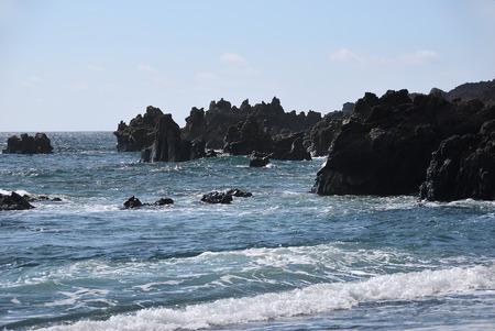 Unusual forms of volcanic cliffs of lava on the rocky shore. Los Hervideros, Lanzarote, Canary Islands. Spain Banco de Imagens