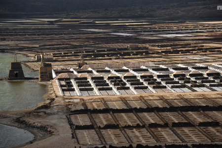 Salt manufacturing. Lanzarote saltworks salinas de Janubio Canary Islands Stock fotó