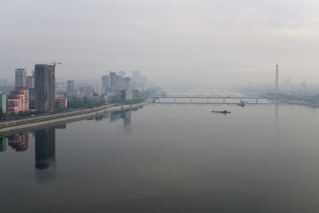 Pyongyang, DPR Korea North Korea and Taedong River in the morning fog. View from the Yanggakdo Hotel