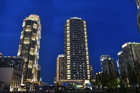 Skyscraper in the new residential complex in the street Ryomyong shown at twilight. Pyongyang, North Korea