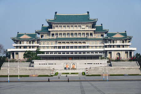Pyongyang, North-Korea - May 1, 2019: The central square of Kim Il Sung. Great Peoples Study House with of portraits of two presidents DPRK on background