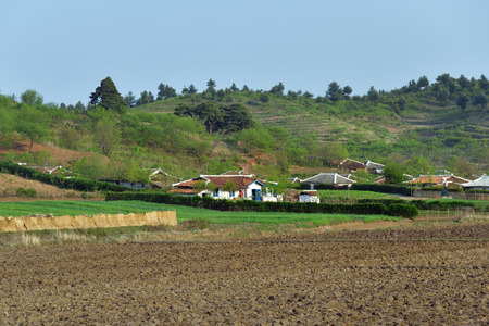 For residents of the countryside. North Korea. DPRK. Village and plowed fields