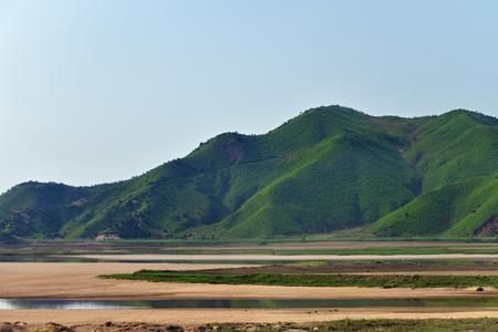 Landscape of North Korea. Green hills nearby Diamond mountains at sunrise Foto de archivo