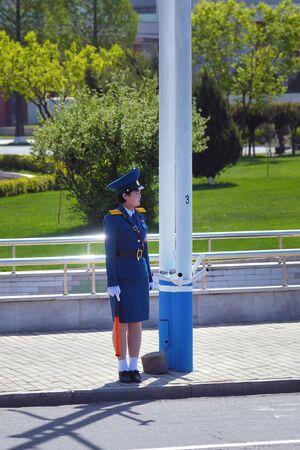 Pyongyang, North Korea - May 2, 2019: Traffic girl regulates traffic at an city street. One of the symbols of Pyongyang