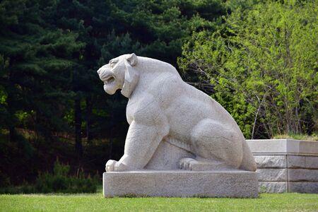 Kaesong, North Korea - May 5, 2019: Granite lion sculpture near Tomb of King Wanggon the founder of the Koryo dynasty. Modern replica