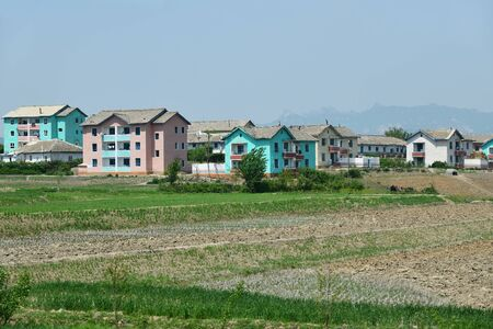 a typical apartment building in Wonsan. All housing for householders is provided by the state for free Фото со стока