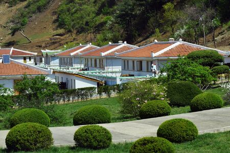 Typical houses of peasants built by the state for residents of countryside. North Korea. DPRK. Village on the mountain slope