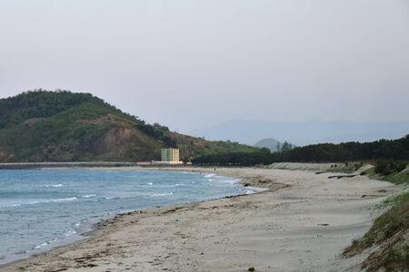 The sand beach at sunset. East Coast of North Korea. Sea of Japan or Eastern Sea